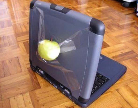 lap top with apple duck tap to it